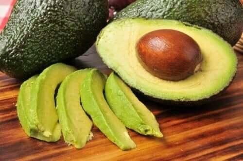 A sliced avocado and half an avocado.