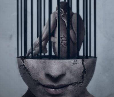 A man in a prison over a brain.