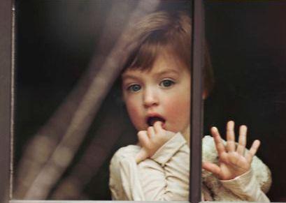 2 child behind window