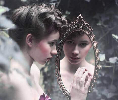 A woman looking into the mirror.