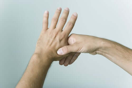 A person pressing on their fingers for eliminating stress.