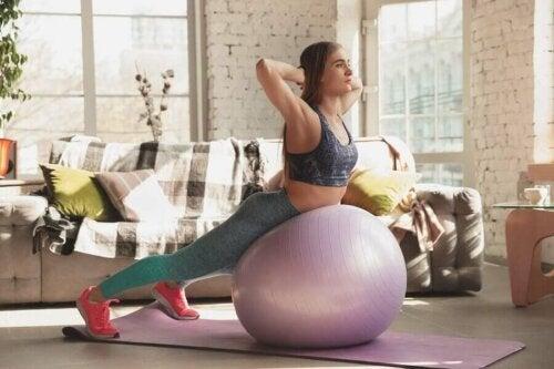 A woman doing exercise on a yoga ball.