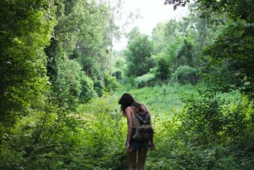 A woman hiking in the forest.