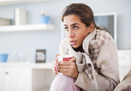 A woman feeling cold.