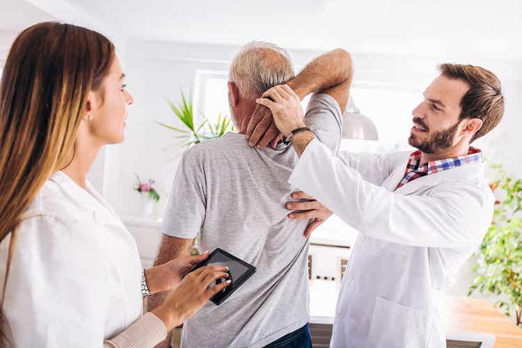 A man undergoing physical therapy for his back.