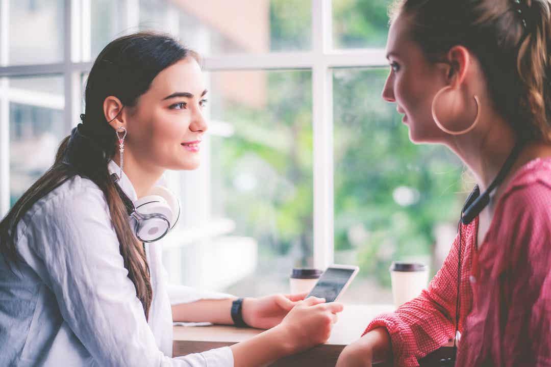 Two young women talking.