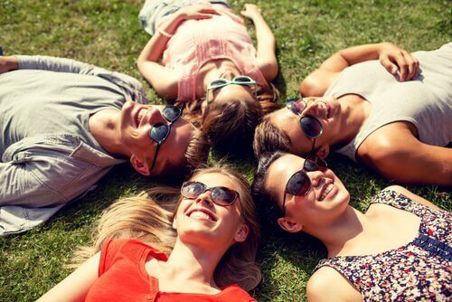 friends laying in a circle on the grass