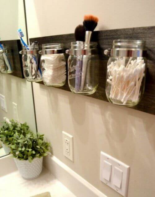 Glass organizers used to save bathroom space