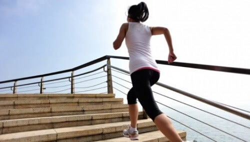 A woman running up some stairs.