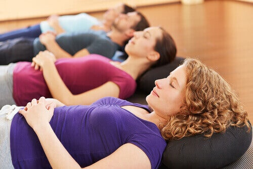 Women doing yoga nidra breathing and relaxation exercises