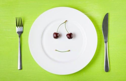 Cherries on plate light dinner for better sleep