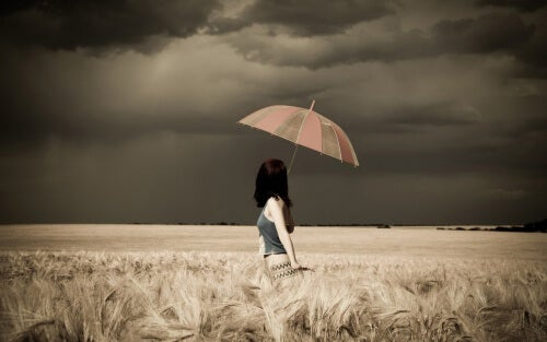 woman umbrella stormy field