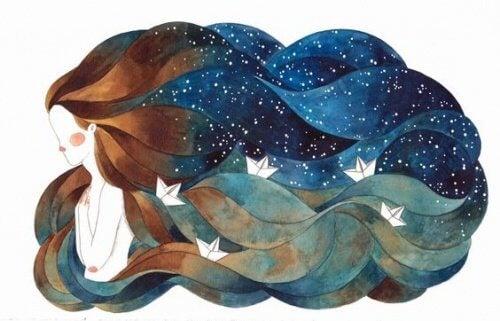 Naisen hiukset meri ja avaruus