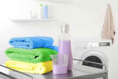 A few clean towels next to fabric softener.