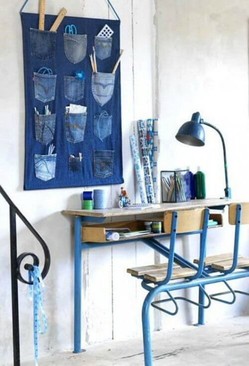 A wall organizer made from old jeans.