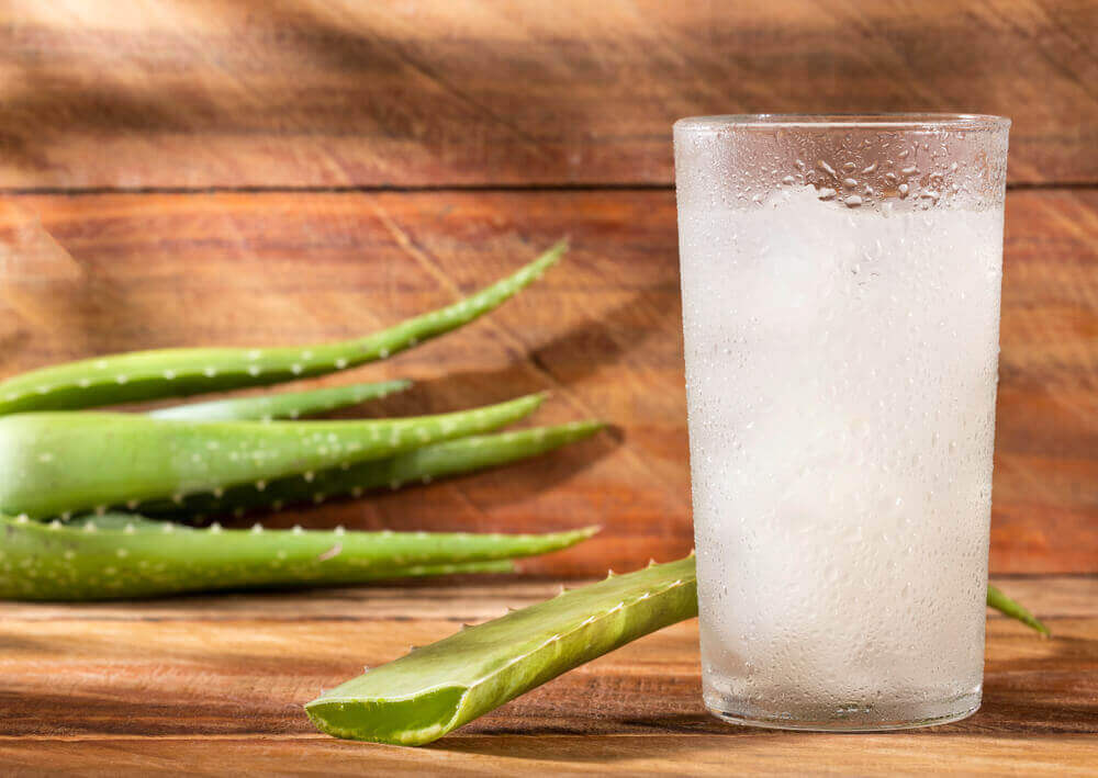 A glass of juice containing aloe vera.