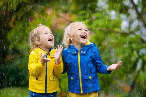 Two boys playing in the rain.