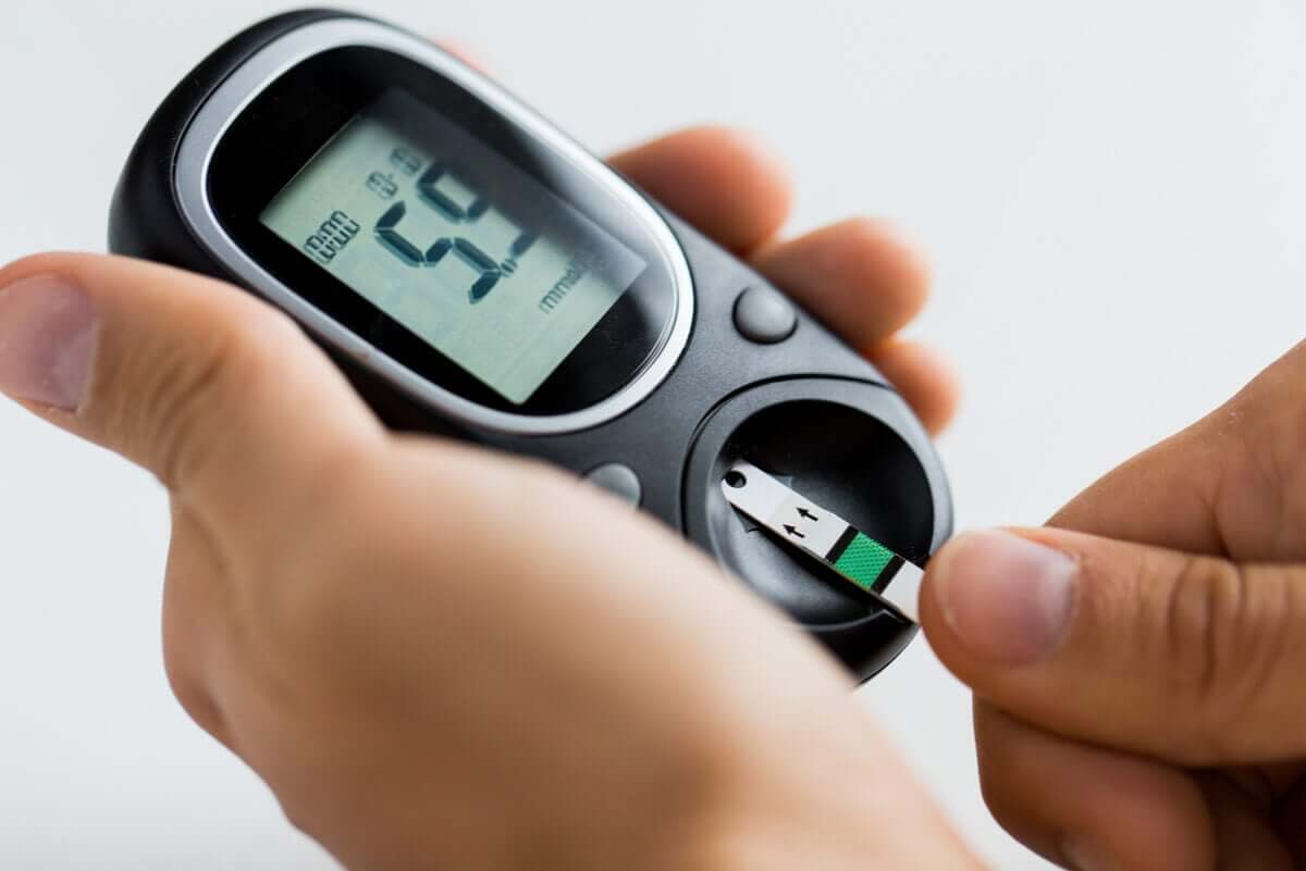 A person testing their blood sugar on a glucometer.