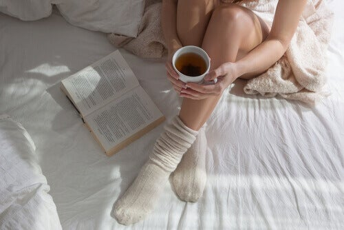 Woman in bed with tea sleep with socks