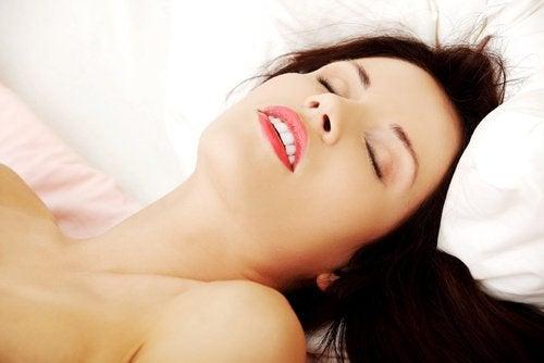 Woman orgasming during sex