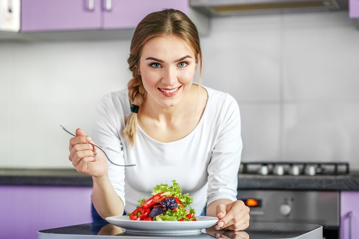A woman eating a salad.