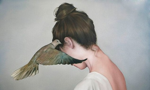 woman with wooden pidgeon at ear