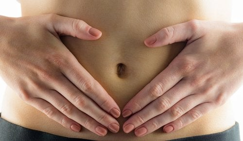 A person with their hands on their belly.