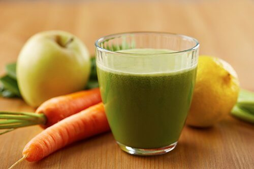 A smoothie with apples carrots and celery.