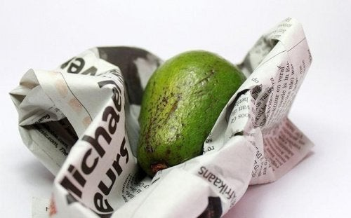 A fruit inside a newspaper sheet.