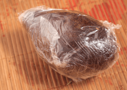 Avocado wrapped in plastic