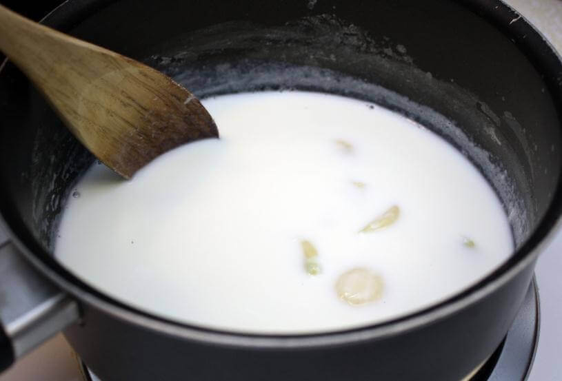 Making garlic milk in a pan