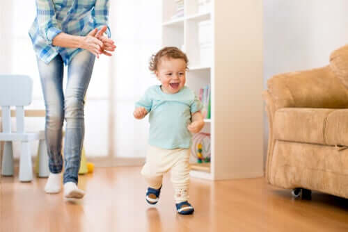 A happy baby running in the living room.