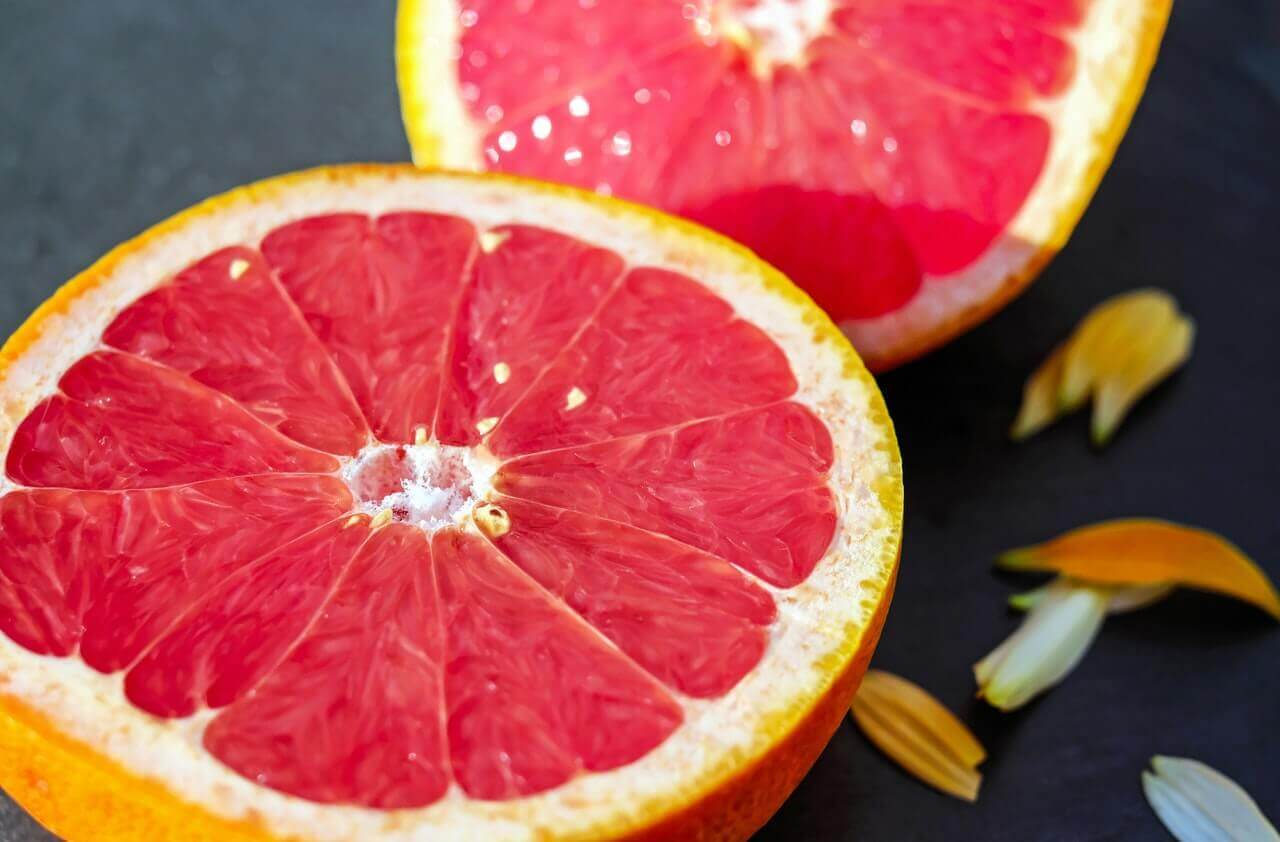 A pink grapefruit cut in half.