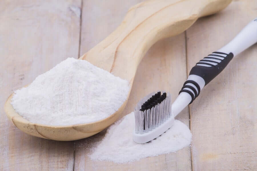 A toothbrush and a spoonful of baking soda.
