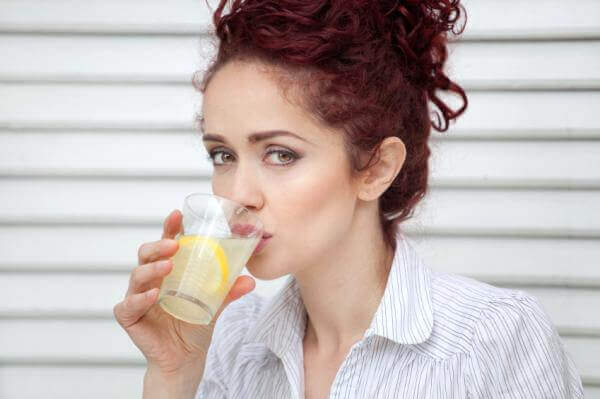 Woman drinking lemonade