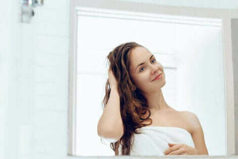 A woman looking at herself in a mirror.