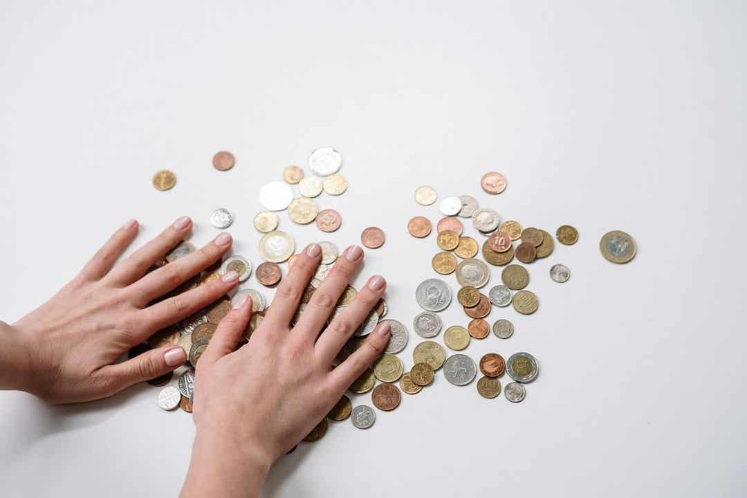 A woman counting coins.