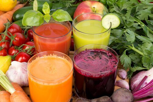 Four different colored smoothies.