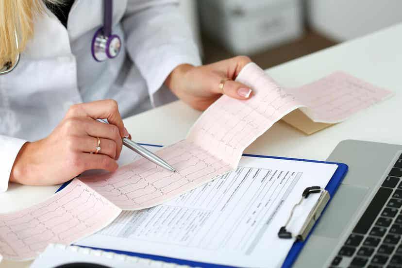 A doctor reading an electrocardiogram.