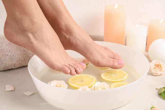 A woman preparing a foot soak.