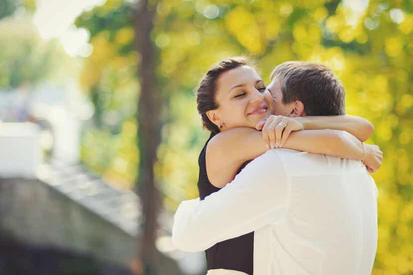 A happy couple hugging.