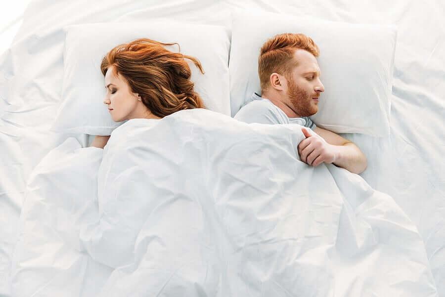 Partners sleeping side-by-side.