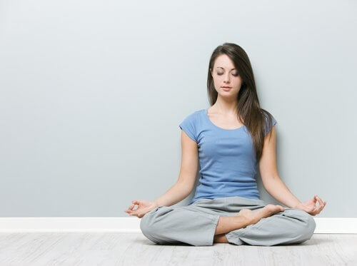Woman doing Lotus position.