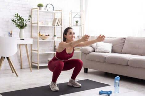 A woman doing squats.