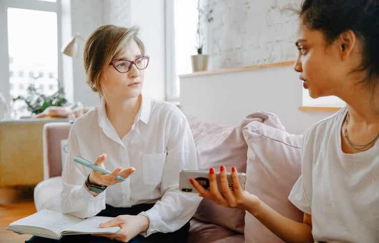 Two woman having a conversation.