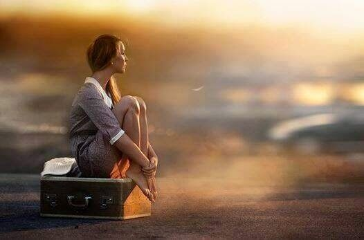 woman-waiting-suitcase