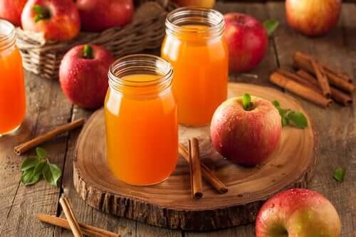 A couple jars of apple juice and cinnamon.