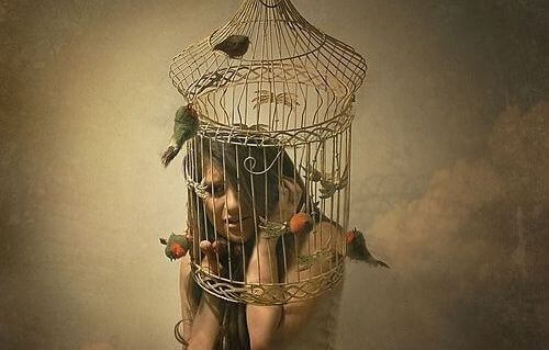 Abused women young woman inside a birdcage psychologically trapped from abuse and violence