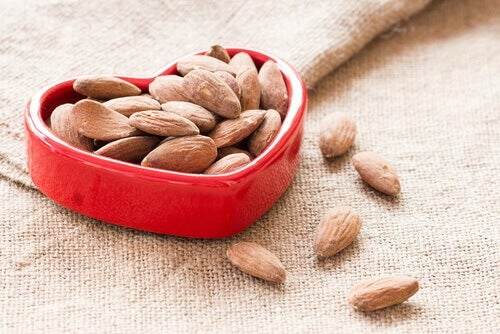 Eat more nuts such as almonds which help improve heart health