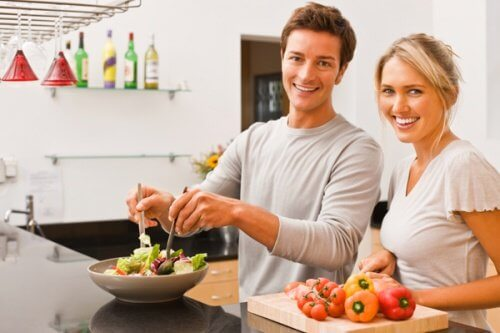 Couple preparing a salad for healthy eating prevent or detect stomach cancer